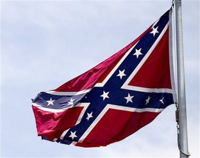 In this June 30, 2015 file photo, a Confederate flag flies at the base of Stone Mountain in Stone Mountain, Ga.  The House is about to put its members on record on whether Confederate flags can decorate rebel graves in historic federal cemeteries and if their sale should be banned in national park gift shops.  The vote comes after southern lawmakers complained that they were sandbagged two nights ago when the House voted — without a recorded tally — to ban the display of Confederate flags at historic federal cemeteries and strengthen Park Service policy against its sale in gift shops. (AP Photo/David Goldman, File)