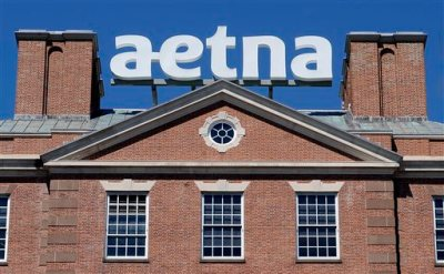 In this Tuesday, Aug. 19, 2014, file photo, a sign for Aetna Inc., sits atop a building at the company headquarters in in Hartford, Conn. Health insurer Aetna Inc. has made a deal to buy competitor Humana Inc. in a $37 billion deal the companies say would create the second-largest managed care company, it was announced Friday, July 3, 2014. (AP Photo/Jessica Hill, File)