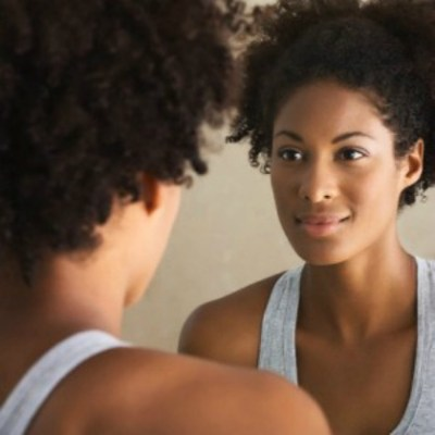 black-woman-looking-in-the-mirror