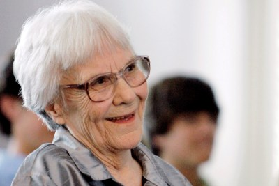 """In this Aug. 20, 2007 file photo, """"To Kill A Mockingbird"""" author Harper Lee smiles during a ceremony honoring the four new members of the Alabama Academy of Honor, at the state Capitol in Montgomery, Ala. The ascendance of Tonja Carter, who worked in Lee's older sister Alice Lee's law office before going to the University of Alabama law school, graduating in 2006 and becoming her partner, brought more aggressive legal tactics on Harper Lee's behalf. (AP Photo/Rob Carr, File)"""
