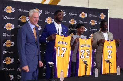 Los Angeles Lakers general manager, Mitch Kupchak, far left, introduces three NBA veterans, Roy Hibbert, 17, Lou Williams, 23, and Brandon Bass, 2, during a news conference in El Segundo, Calif., on Wednesday, July 22, 2015. Hibbert is a two-time NBA All-Star center eager to revitalize his career after seven seasons in Indiana while Williams was the Sixth Man of the Year with Toronto last season. (AP Photo/Greg Beachman)