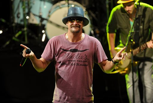 This May 5, 2015 file photo shows musician Kid Rock performing during  National Concert Day in New York. Activists in Detroit trying to persuade Kid Rock to stop displaying the Confederate flag at concerts plan to meet this week with General Motors over the Chevrolet brand's sponsorship of the musician's summer tour. (Photo by Brad Barket/Invision/AP, File)