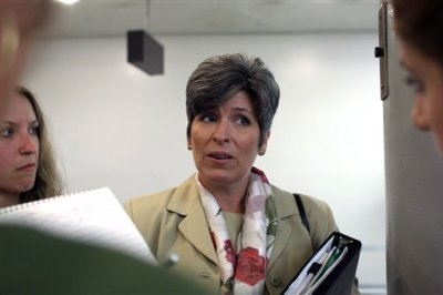 Sen. Joni Ernst, R-Iowa, speaks to reporters about Planned Parenthood on Monday, Aug. 3, 2015 on Capitol Hill in Washington. The Senate blocked a Republican drive Monday to terminate federal funds for Planned Parenthood, setting the stage for the GOP to try again this fall amid higher stakes (AP Photo/Lauren Victoria Burke)