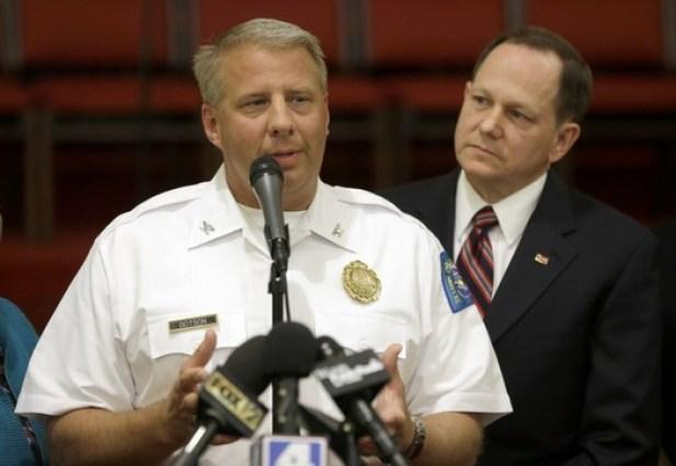 St. Louis police chief Sam Dotson, left, appeals for calm alongside mayor Francis Slay, Thursday, Aug. (Jeff Roberson/AP)
