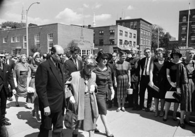 n this Aug. 24, 1965, file photo, Connie Daniels, right, mother of Jonathan Daniels, the young seminarian and civil rights worker slain in Hayneville, Ala., arrives at a church in Keene, N.H., to attend her son's funeral. She is accompanied by Etta Weaver, center, maternal grandmother, of Bradford, Vt., and funeral director Frank J. Foley. Fifty years after Daniels' death, the people who stood with him that day in Alabama look at deaths in Ferguson, Mo., Baltimore and Charleston, S.C., and lament the country's persistent racial divide. (AP Photo/Bill Chaplis, File)