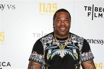 "In this Sept. 30, 2014, file photo, rapper Busta Rhymes attends the premiere of ""Nas: Time Is Illmatic"" at the Museum of Modern Art in New York. Rhymes was arrested Wednesday, Aug. 5, 2015, following a dispute at a gym in New York. (Photo by Greg Allen/Invision/AP, File)"