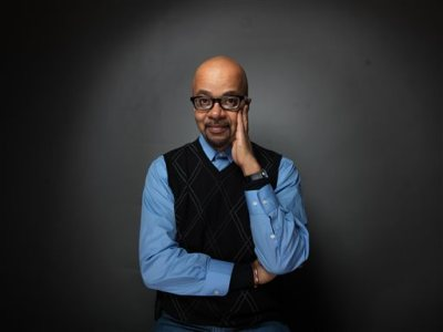 """In this Monday, Jan. 23, 2012, file photo, author and filmmaker James McBride poses for a portrait during the 2012 Sundance Film Festival in Park City, Utah. National Book Award winner McBride is returning to nonfiction for his next project. The author of """"The Good Lord Bird"""" has a deal with Spiegel & Grau for a book about the late James Brown. """"Kill 'Em and Leave: Searching for the Real James Brown"""" is tentatively scheduled for March 2016. (AP Photo/Victoria Will, File)"""