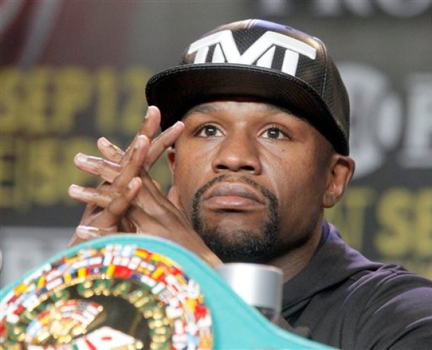 Floyd Mayweather Jr. takes questions during a news conference in Los Angeles on Thursday, Aug. 6, 2015. Mayweather is scheduled to face Andre Berto in a boxing bout Sept. 12 in Las Vegas. (AP Photo/Nick Ut)