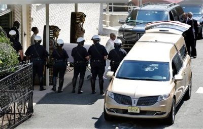 Carolyn Whigham leads Bobbi Kristina Brown's casket to a hearse after a service at Whigham funeral home in Newark, N.J., early Monday, Aug. 3, 2015. Bobbi Kristina, the only child of Whitney Houston and R&B singer Bobby Brown, died in hospice care July 26, about six months after she was found face-down and unresponsive in a bathtub in her suburban Atlanta home. (AP Photo/Mel Evans)