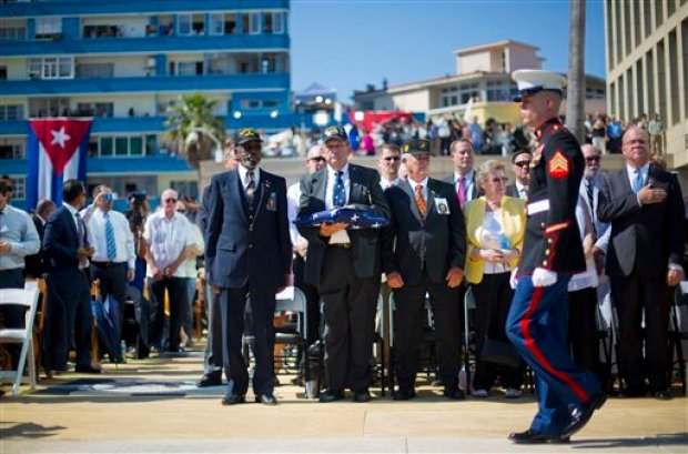 Retired Marines, from left, Gunnery Sgt. Francis 'Mike' East, Gunnery Sgt. James Tracy, and Cpl. Larry Morris, wait to present the U.S. flag to Marines currently stationed in Cuba, during the raising of the U.S. flag over the newly reopened embassy in Havana, Cuba. Friday, Aug. 14, 2015. East, Tracy and Morris where part of the Marines that had originally lowered the American flag in 1961 and promised to return the flag. (AP Photo/Pablo Martinez Monsivais, Pool)