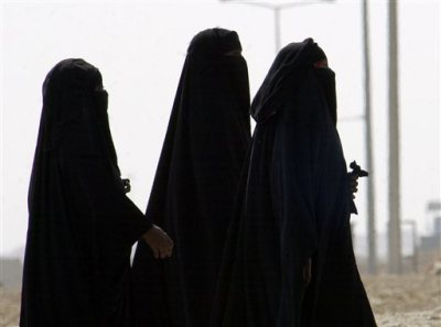 In this Nov. 15, 2006, file photo, Saudi women walk along a suburban street in Riyadh, Saudi Arabia. A video uploaded online in July 2015 that shows two young Saudi women being harassed by several young men on a seaside promenade in the coastal city of Jiddah has sparked a rare public debate on the rights of women in this ultra-conservative Muslim country that imposes a strict segregation of the sexes. (AP Photo/Hasan Jamali, File)
