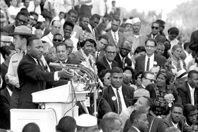 """In this Aug. 28, 1963 photo, The Rev. Dr. Martin Luther King Jr., head of the Southern Christian Leadership Conference, gestures during his """"I Have a Dream"""" speech as he addresses thousands of civil rights supporters gathered in Washington, D.C. onths before the Rev. Martin Luther King Jr. delivered his famous """"I Have a Dream"""" speech to hundreds of thousands of people gathered in Washington in 1963, he fine-tuned his civil rights message before a much smaller audience in North Carolina. Reporters had covered King's 55-minute speech at a high school gymnasium in Rocky Mount on Nov. 27, 1962, but a recording wasn't known to exist until English professor Jason Miller found an aging reel-to-reel tape in the town's public library. (AP Photo)"""