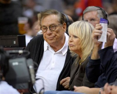 In this Nov. 7, 2012, file photo, Los Angeles Clippers owners Donald Sterling, left, and his wife Shelly Sterling watch the Clippers play the San Antonio Spurs during an NBA basketball game in Los Angeles. The former team owner has filed for divorce from Shelly Sterling, his attorney Bobby Samini said Wednesday, Aug. 5, 2015. (AP Photo/Mark J. Terrill, File)