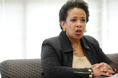 """In this July 21, 2015 file photo, Attorney General Loretta Lynch speaks in East Haven, Conn. Lynch is voicing her support for police officers in a speech before the National Fraternal Order of Police. At a conference in Pittsburgh on Monday, Lynch thanked police for running toward danger and """"working to maintain the peace."""" (AP Photo/Jessica Hill, File)"""