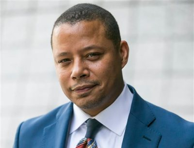"""In this Thursday, Aug. 13, 2015 file photo, actor Terrence Howard walks into a Los Angeles court for a hearing in which he is attempting to overturn a 2012 divorce settlement on the grounds his ex-wife Michelle Ghent extorted him, in Los Angeles. A judge said Monday, Aug. 17, 2015, that he will issue a ruling next week on whether Howard can overturn the divorce settlement that entitles his ex-wife to spousal support payments, including earnings from his work on the hit show, """"Empire.""""  (AP Photo/Damian Dovarganes, File)"""