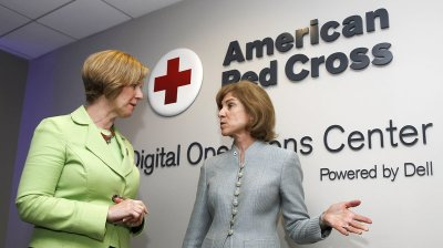 American Red Cross chief Gail McGovern (right) and Rep. Susan Brooks of Indiana tour the American Red Cross Digital Operations Center last year in Washington, D.C. (Paul Morigi/AP Images for American Red Cross)