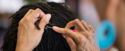 Ayana Hardin creates natural hair twists. (Erin Mizelle/Winston-Salem Chronicle)