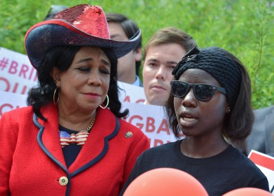 Lili, one of the Chibok schoolgirls that escaped Boko Haram militants last April speaks during the #BringBackOurGirls press conference hosted by Rep. Frederica Wilson (D-Fla.) (left) at the U.S. Capitol in Washington, D.C. (Freddie Allen/NNPA News Wire)