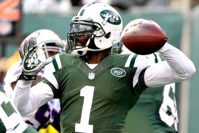 New York Jets quarterback Michael Vick (1) throws a pass during the first half of an NFL football game against the Buffalo Bills, Sunday, Oct. 26, 2014, in East Rutherford, N.J. (AP Photo/Seth Wenig)