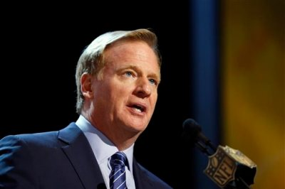 In this Thursday, April 30, 2015 file photo, NFL commissioner Roger Goodell speaks during the first round of the 2015 NFL Football Draft in Chicago. Without the games to distract from the issues, football fans were left to ponder the NFL's policies, its commissioner and its overall credibility during an uncomfortable offseason for the league. (AP Photo/Charles Rex Arbogast, File)
