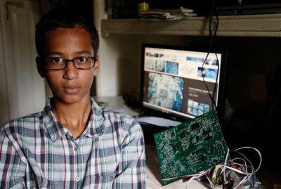 Irving MacArthur High School student Ahmed Mohamed, 14, poses for a photo at his home in Irving, Texas on Tuesday, Sept.  15, 2015. Mohamed was arrested and interrogated by Irving Police officers on Monday after bringing a homemade clock to school. Police don't believe the device is dangerous, but say it could be mistaken for a fake explosive. He was suspended from school for three days, but he has not been charged. (Vernon Bryant/The Dallas Morning News via AP)