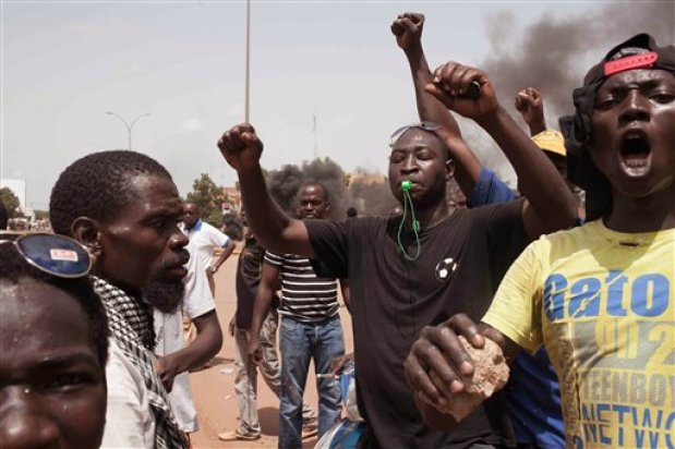 Burkina Faso protestors take to the streets in the city of Ouagadougou, Burkina Faso, Thursday, Sept. 17, 2015.  While gunfire rang out in the streets, Burkina Faso's military took to the airwaves Thursday to declare it now controls the West African country, confirming that a coup had taken place just weeks before elections. (AP Photo/Theo Renaut)