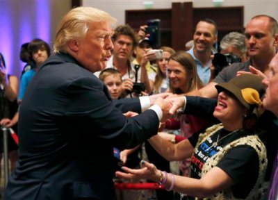 Republican presidential candidate, businessman Donald Trump, greets supporters after speaking at an event sponsored by the Greater Charleston Business Alliance and the South Carolina African American Chamber of Commerce at the Charleston Area Convention Center in North Charleston, S.C., Wednesday, Sept. 23, 2015. (AP Photo/Mic Smith)
