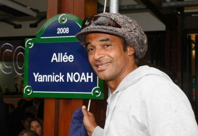 In this May 27, 2008 file photo, former tennis ace Yannick Noah, of France, winner of the French Open tennis tournament in 1983, inaugurates a walking path which bears his name, at the Roland Garros stadium in Paris. Yannick Noah, the last Frenchman to win a Grand Slam tournament, has been appointed as the new France Davis Cup captain, Monday Sept.21, 2015. (Michel Spingler/AP Photo)