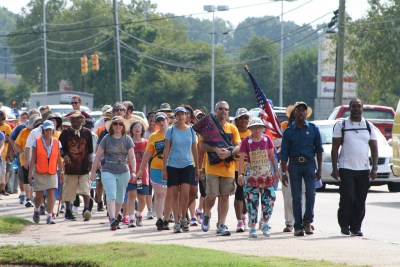 Journey for Justice marchers travel down Wilmington Street toward the State Capitol building in Raleigh. The march was led by 85-year-old Ruth Zalph (left), wearing a Black Lives Matter sign and Cornell William Brooks (right), president of NAACP. (Photos by Afrique Kilimanjaro/Carolina Peacemaker)