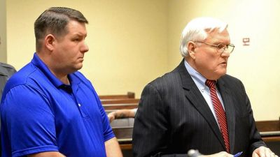 In a Thursday, Dec. 4, 2014 file photo, Richard Combs, left, the former police chief and sole officer in the small town of Eutawville, S.C., listens in court with his lawyer John O'Leary, in Orangeburg, S.C. Solicitor David Pascoe said in opening arguments Wednesday, Jan. 7, 2015 that Bernard Bailey was murdered over a broken taillight by then-Eutawville Police Chief Combs. But Combs' lawyer O'Leary says the chief had a legitimate warrant against Bailey, and the victim turned his pickup truck into a weapon when he tried to back away as Combs tried to arrest him. (AP Photo/The Times and Democrat, Larry Hardy)