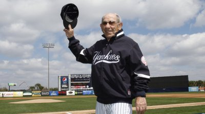 New York Yankees Hall of Fame catcher Yogi Berra has died at age 90. He's seen here being introduced before a Yankees spring training baseball game in 2010. (Kathy Willens/AP)