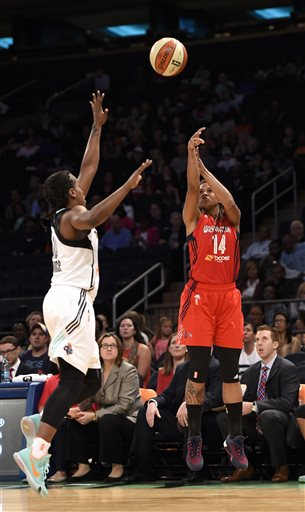 Washington Mystics guard Tierra Ruffin-Pratt (14) shoot a 3-pointer over New York Liberty guard Epiphanny Prince (10) during the first half of a WNBA Eastern Conference basketball playoff game Tuesday, Sept. 22, 2015, in New York. (AP Photo/Kathy Kmonicek)