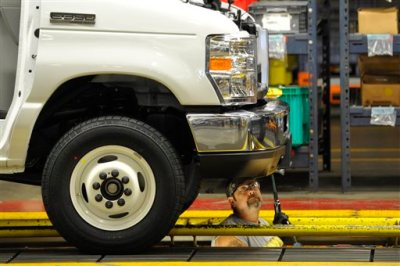 In this Aug. 12, 2015 photo, a worker works on the production line at Ford Motor Company's Ohio Assembly Plant in Avon Lake, Ohio. Major automakers report sales figures for August on Tuesday, Sept. 1, 2015. (AP Photo/David Richard)