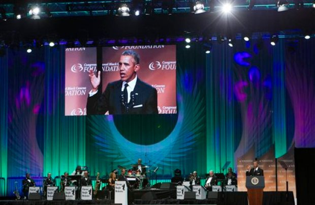 "President Barack Obama speaks at the Congressional Black Caucus Foundation's 45th Annual Legislative Conference Phoenix Awards Dinner at the Walter E. Washington Convention Center in Washington, Saturday, Sept. 19, 2015, about black women's role in helping shape American democracy, calling them ""the thinkers and the doers"" who made things happen at the height of the civil rights movement half a century ago. ( AP Photo/Jose Luis Magana)"