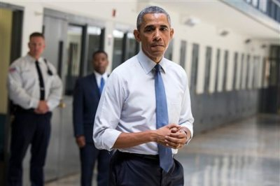 "In this July 16, 2015, file photo, President Barack Obama pauses as he speaks at the El Reno Federal Correctional Institution in El Reno, Okla. An HBO documentary, ""Fixing the System"", that  features President Obama's historic visit to the prison, and his in-depth conversations with six of the inmates premiered Wednesday, Sept. 23, at the prison before a group of inmates. (AP Photo/Evan Vucci, File)"