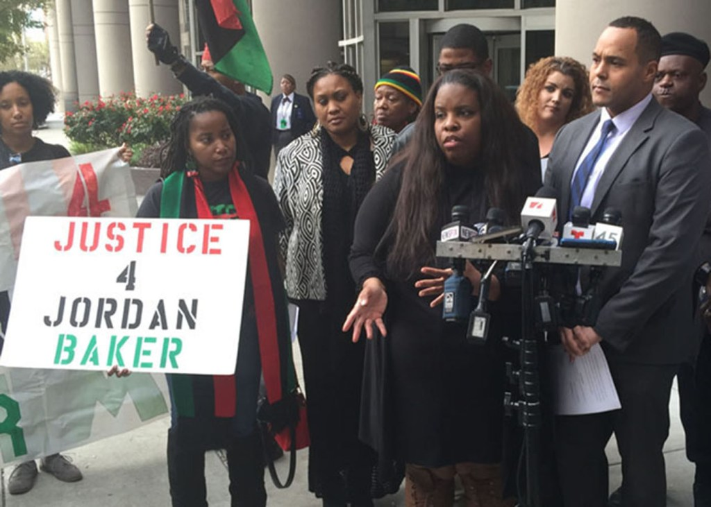 Janet Baker, mother of Jordan Baker and Attorney David Owens discuss federal lawsuit with media. (Jeffrey L. Boney/Houston Forward Times)