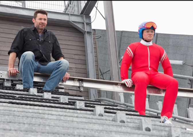 "Hugh Jackman (left) and Taron Egerton star in ""Eddie The Eagle."" (Twentieth Century Fox)"