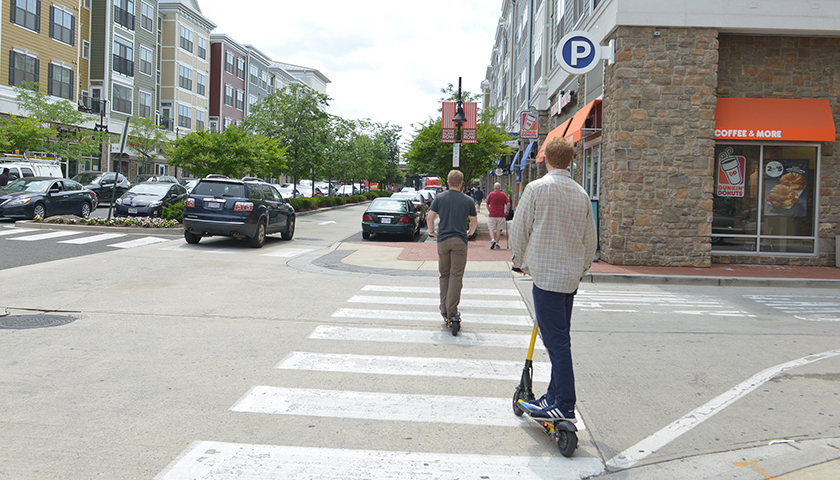 People ride motorized scooters at Rhode Island Row in Northeast, Washington, D.C. (Freddie Allen/AMG/NNPA)