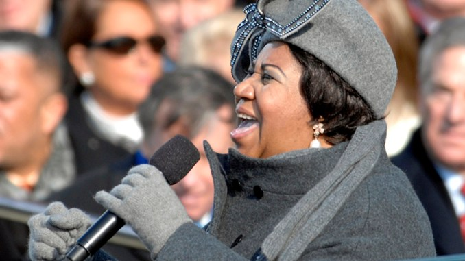 "Legendary singer/songwriter Aretha Franklin is gravely will. In this photo, Franklin sings ""My Country 'Tis Of Thee'"" at the U.S. Capitol during President Barack Obama's inauguration in Washington, D.C., Jan. 20, 2009. (Cecilio Ricardo/U.S. Air Force/Wikimedia Commons)"