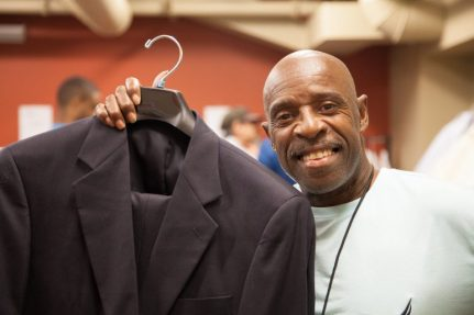 One of a dozen program participants who snagged suits at Avivo's annual Men's Wearhouse suit giveaway.