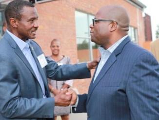Detroit Pistons head coach chatting with Michigan Chronicle publisher Hiram E. Jackson. PHOTO: Monica Morgan