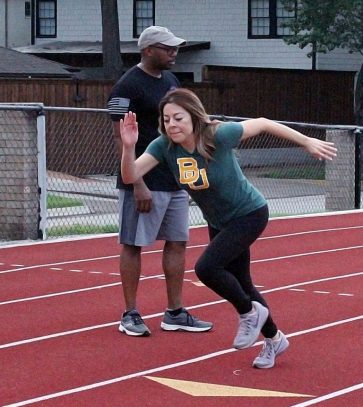 MaryAnn Martinez of CBS11 takes off at the start of a 300-meter sprint, one of four FBI physical fitness tests to screen potential applicants. (Photo: David Wilfong / NDG)
