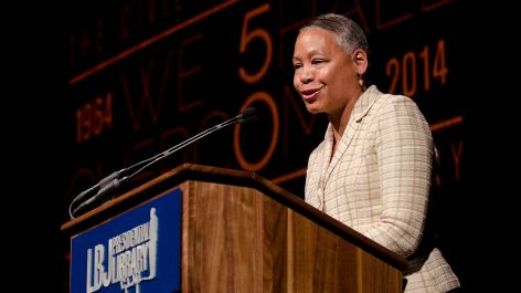 """Lisa Borders, chair of the Coca-Cola Foundation, made introductory remarks at the panel on """"Social Justice in the 21st Century: Empowering Minds, Changing Hearts and Inspiring Service."""" Photo by Marsha Miller."""