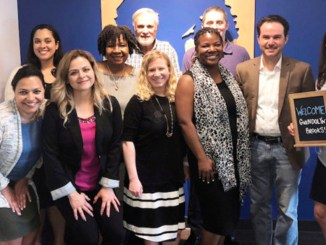 Schuler Scholar Program staffers welcomed Gwendolyn Brooks College Preparatory Academy Principal Shannae Jackson (center, b/w scarf) to their Lake Forest office on June 20, 2018 for a meeting about the launch of a new Schuler Scholar partnership at Brooks Academy during the 2018-19 academic year. Photo courtesy Schuler Scholar Program.
