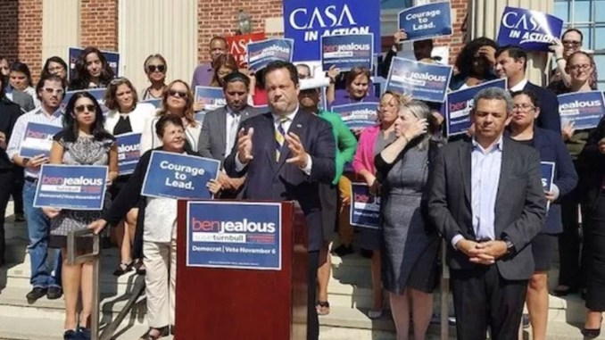 Maryland Democratic gubernatorial candidate Ben Jealous (at podium) stands with Latino leaders and other supporters outside CASA de Maryland's Multicultural Center in Langley Park during an Oct. 1 campaign rally. (William J. Ford/The Washington Informer)