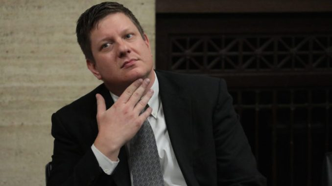 Amid jury deliberations Chicago police Officer Jason Van Dyke listens while attorneys step before Judge Vincent Gaughan bench, as the jury has sent another question to Judge Gaughan, who read it aloud from the bench, at the Leighton Criminal Court Building Friday, Oct. 5, 2018. (Antonio Perez/pool/Chicago Tribune)