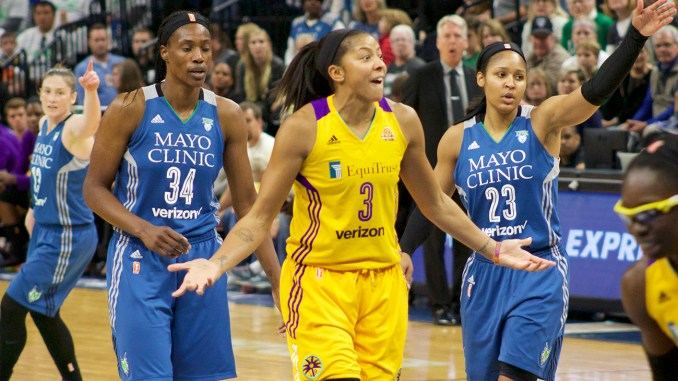 f686bbd5bf4 Candace Parker of the Los Angeles Sparks surrounded by the Minnesota Lynx