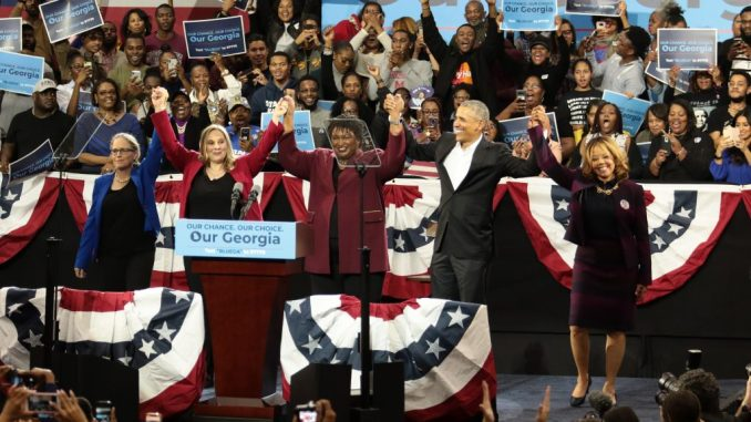 (Left to right) Carolyn Bourdeaux, Sarah Riggs Amico, Stacey Abrams, former U.S. President Barack Obama, and Lucy McBath celebrate on stage at a campaign rally at Morehouse College's Forbes Arena on Friday, November 2, 2018. (Photo: Itoro N. Umontuen / The Atlanta Voice)