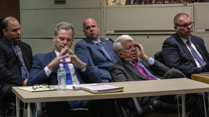 Chicago police Officer Thomas Gaffney, left, ex-Officer Joseph Walsh and former Detective David March sit during a pre-trial hearing with Judge Domenica A. Stephenson at Leighton Criminal Court Building on Tuesday. In front are their attorneys William Fahy (left) and Thomas Breen. | Zbigniew Bzdak/Chicago Tribune/Pool