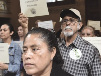 Members of East Oakland Congress of Neighborhoods rally at City Hall to demand the city keep its promises to clean up trash and illegal dumping. Photo by Ken Epstein.